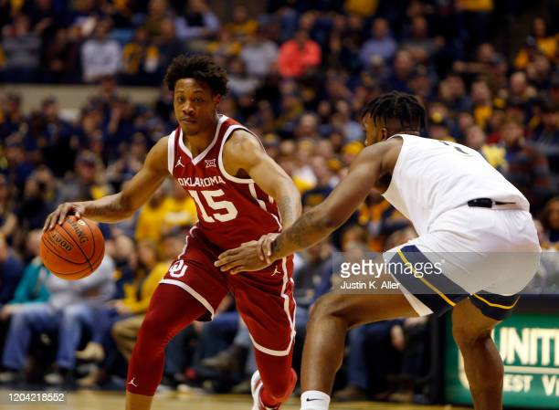 Alondes Williams of the Oklahoma Sooners handles the ball against the West Virginia Mountaineers at the WVU Coliseum on February 29 2020 in...