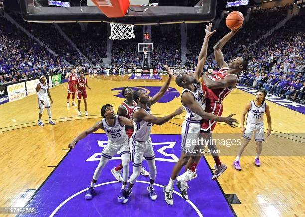 Alondes Williams of the Oklahoma Sooners puts up a shot against DaJuan Gordon of the Kansas State Wildcats during the second half at Bramlage...
