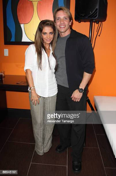 Alondra and Rene Farrait attend the Rocco Donna Coral Gables Salon grand opening on June 17, 2009 in Coral Gables, Florida.