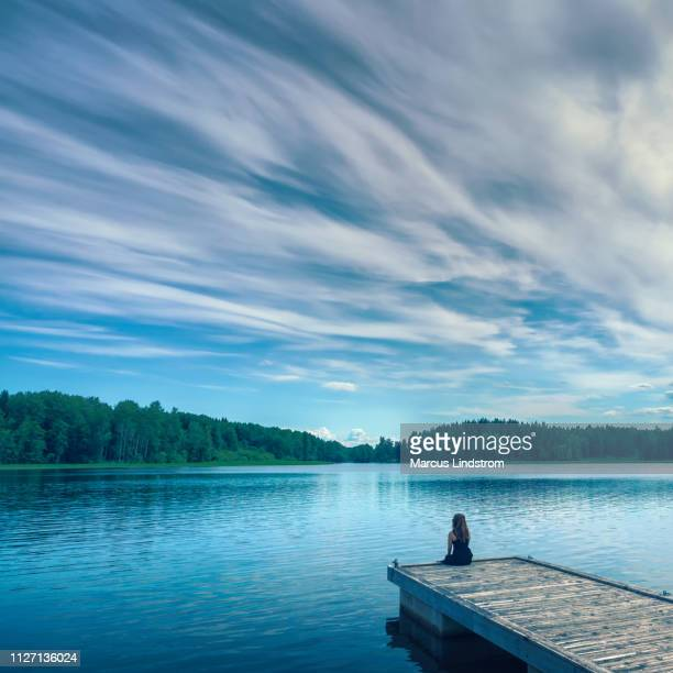 alone by the lake - lake stock pictures, royalty-free photos & images