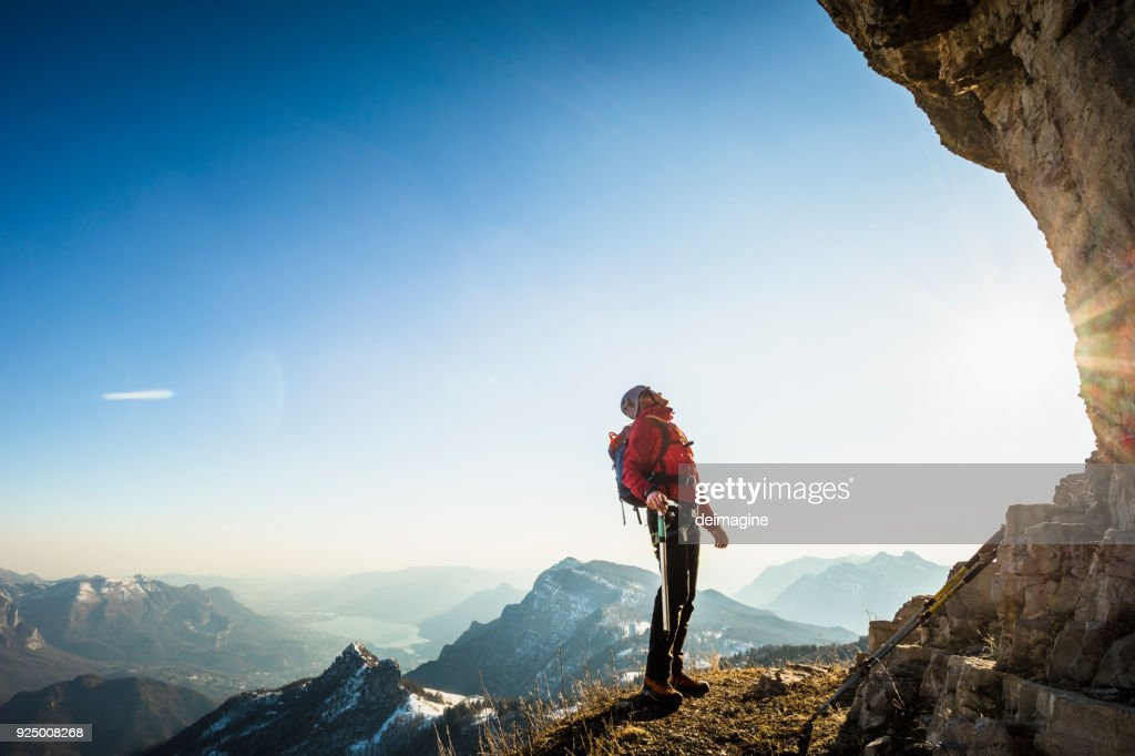 Alone climber lokking at mountain : Stock Photo