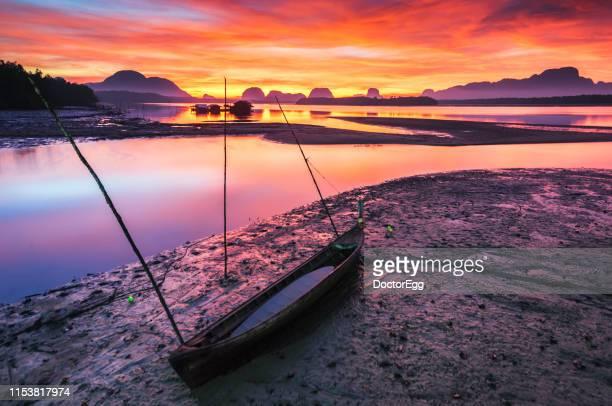 Alone Fisherman Boat and Sunrise at Sam Chong Tai Fisherman Village, Phang-gna Province, Thailand