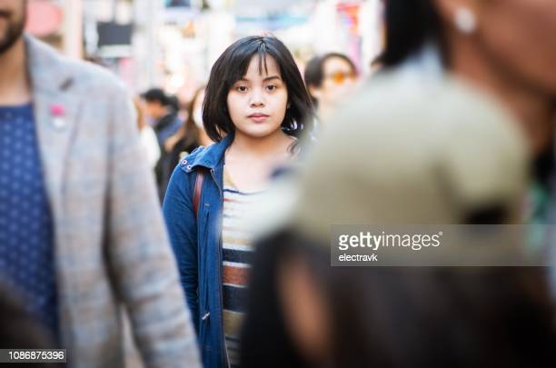 alone in a crowd - image focus technique stock pictures, royalty-free photos & images