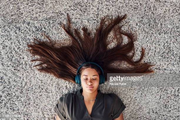 alone in a world of music - lying down stock pictures, royalty-free photos & images