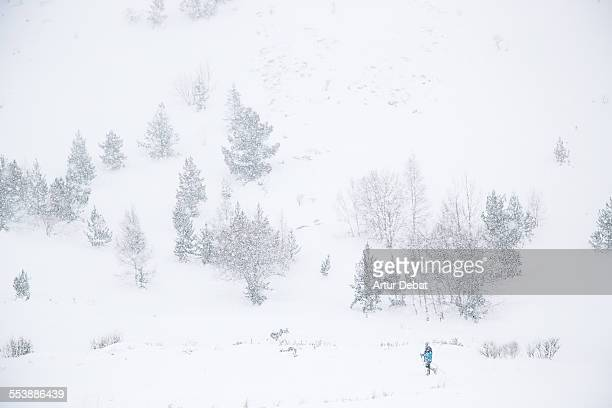 Alone man trekking the Pyrenees on heavy snow.