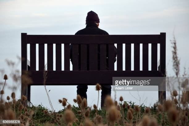 alone on the bench - grief stock pictures, royalty-free photos & images