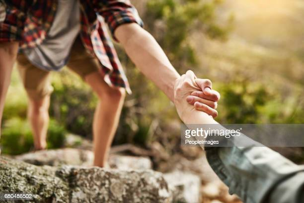alone we climb rocks, together we climb mountains - climbing stock pictures, royalty-free photos & images