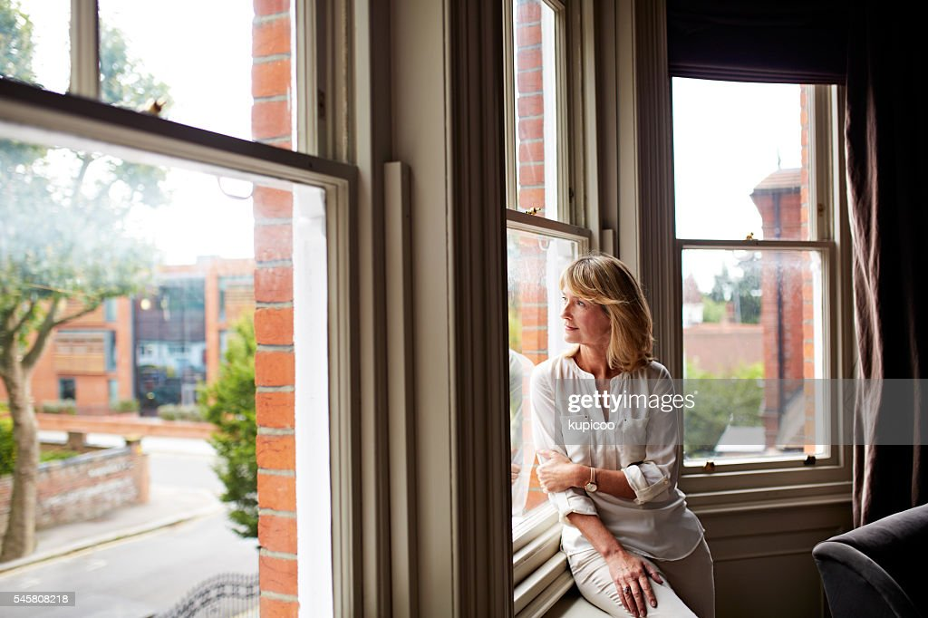 Alone with her thoughts : Stock Photo