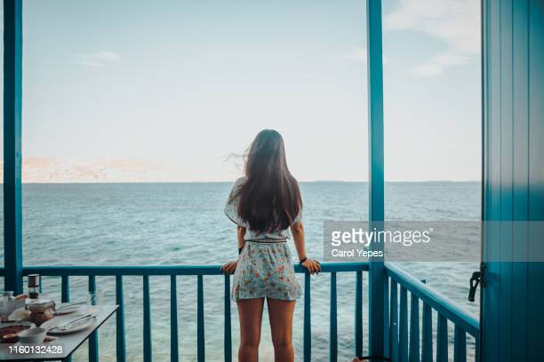 alone woman looking out the blue sea - boulder colorado stock pictures, royalty-free photos & images