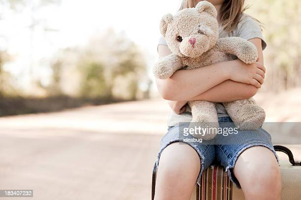 Alone Young Girl Hugging Old, Raggedy Teddy Bear