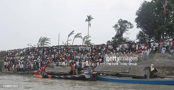 NDRF along with BSF and CRPF operating the rescue operation in Dhubri district of Assam where a ferry with over 250 people on board capsized in heavy...