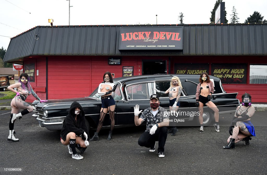 Strip Club Keep Business Open Using Dancers As Food Delivery Staff : News Photo
