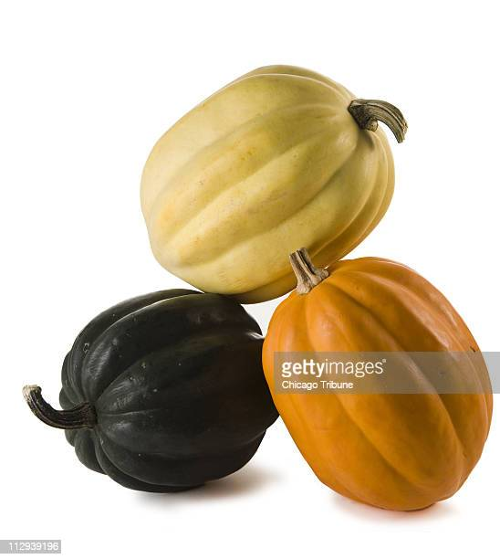 Along with the usual deep forest green acorn squash comes in hues of yellow and creamy white