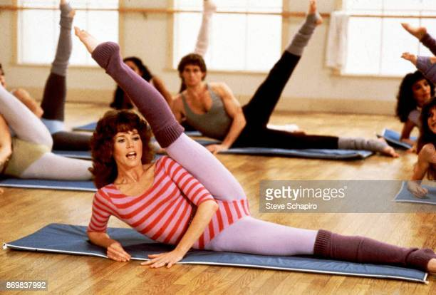 Along with unidentified others American actress Jane Fonda exercises during a photo shoot for 'Jane Fonda's Workout Book' Los Angeles California 1981