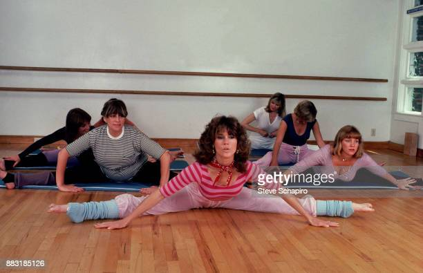 Along with unidentified others, American actress Jane Fonda exercises during a photo shoot for 'Jane Fonda's Workout Book,' Los Angeles, California,...