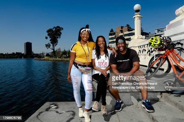 Alonna Blackburn Kaye Sweat and Robert Sweat pose for a Mother's Day family portrait at Lake Merritt in Oakland, Calif., on Sunday, May 12, 2019....