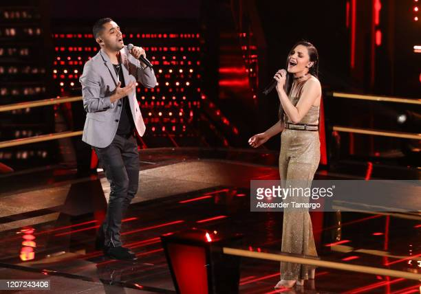 Alonso Garcia and Tiffany Galaviz are seen performing on stage during Telemundo's La Voz Batallas Round 2 at Cisneros Studios on March 15 2020 in...