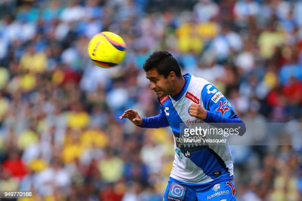 Alonso Zamora of Puebla heads the ball during the 16th round match between Puebla and America as part of the Torneo Clausura 2018 Liga MX at...