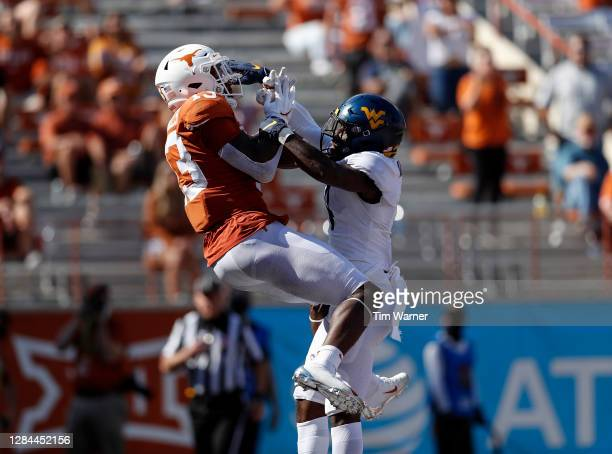 Alonzo Addae of the West Virginia Mountaineers breaks up a pass intended for Brennan Eagles of the Texas Longhorns in the end zone in the third...