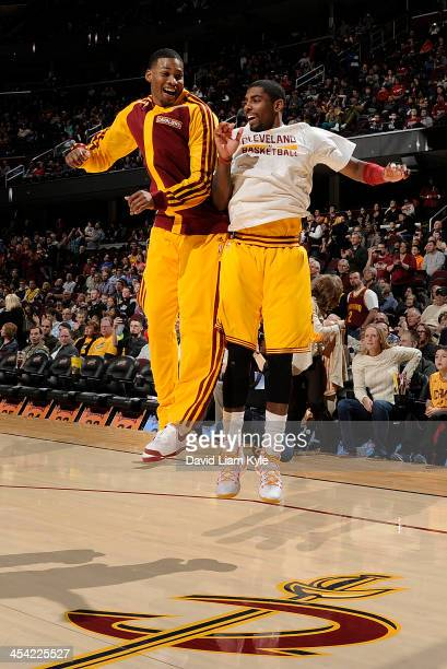 Alonzo Gee and Kyrie Irving of the Cleveland Cavaliers chest bump each other during introductions prior to the game against the Los Angeles Clippers...