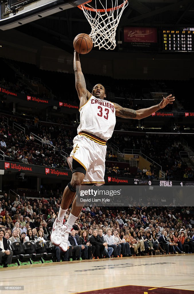 Alonzo Gee #33 of the Cleveland Cavaliers goes for a dunk against the San Antonio Spurs at The Quicken Loans Arena on February 13, 2013 in Cleveland, Ohio.