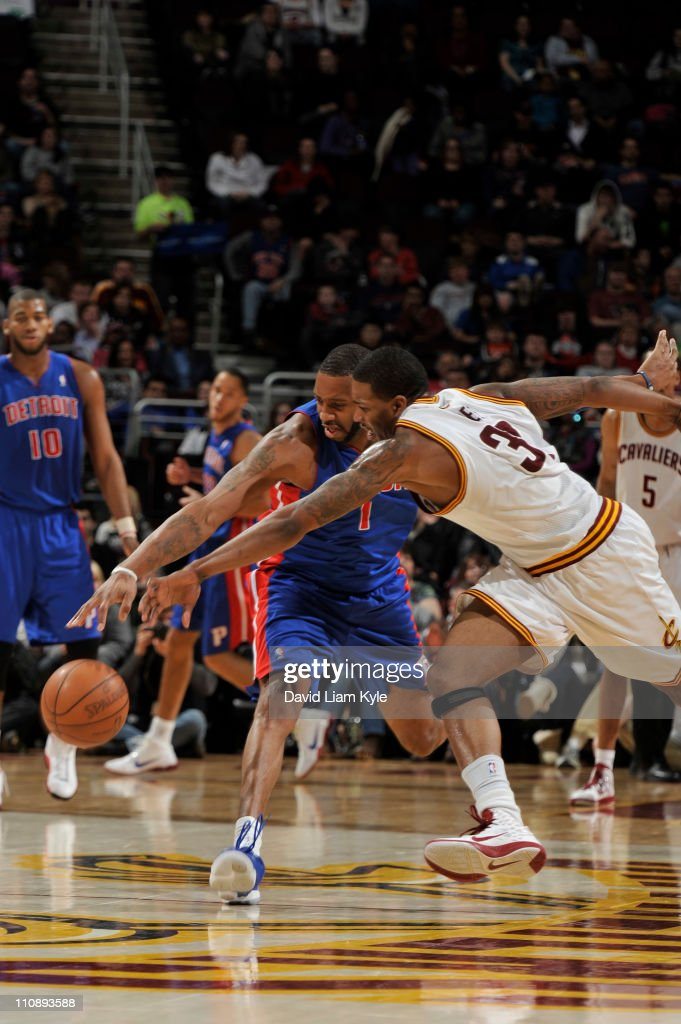 Alonzo Gee #33 of the Cleveland Cavaliers goes for the loose ball against Tracy McGrady #1 of the Detroit Pistons during the game at The Quicken Loans Arena on March 25, 2011 in Cleveland, Ohio.