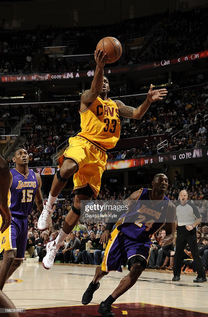Alonzo Gee #33 of the Cleveland Cavaliers goes to the basket against Kobe Bryant #24 of the Los Angeles Lakers at The Quicken Loans Arena on December 11, 2012 in Cleveland, Ohio.