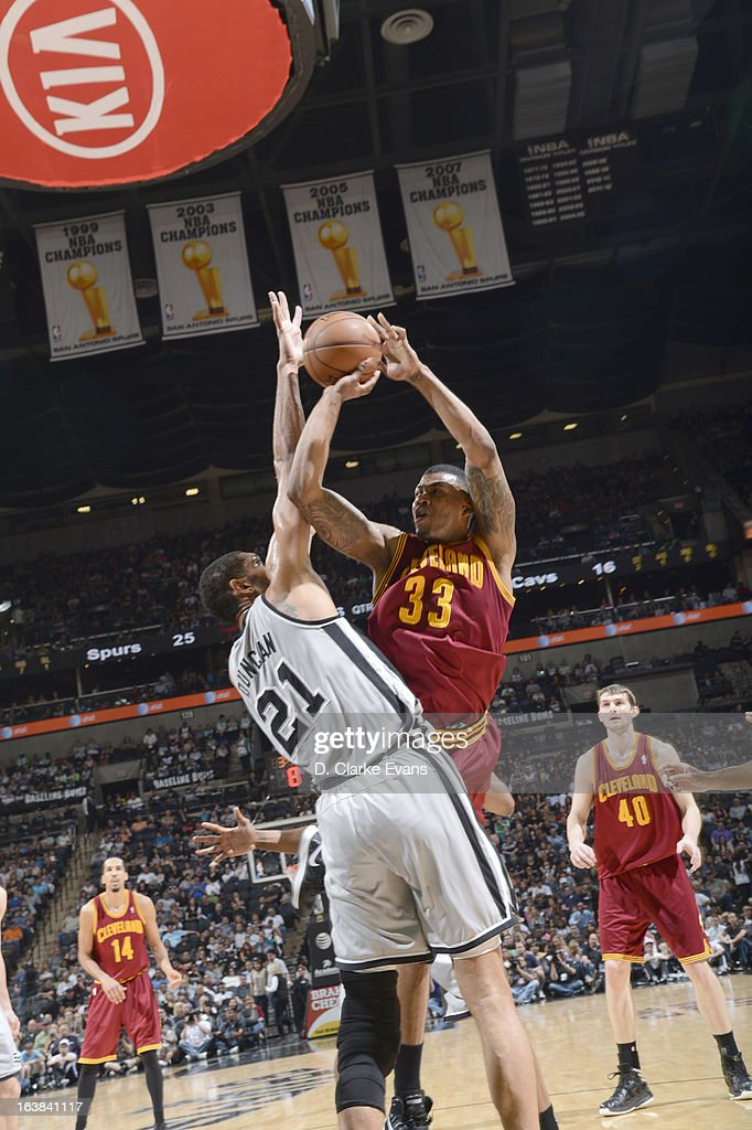 Alonzo Gee #33 of the Cleveland Cavaliers goes to the basket against Tim Duncan #21 of the San Antonio Spurs during the game between the Cleveland Cavaliers and the San Antonio Spurs on March 16, 2013 at the AT&T Center in San Antonio, Texas.