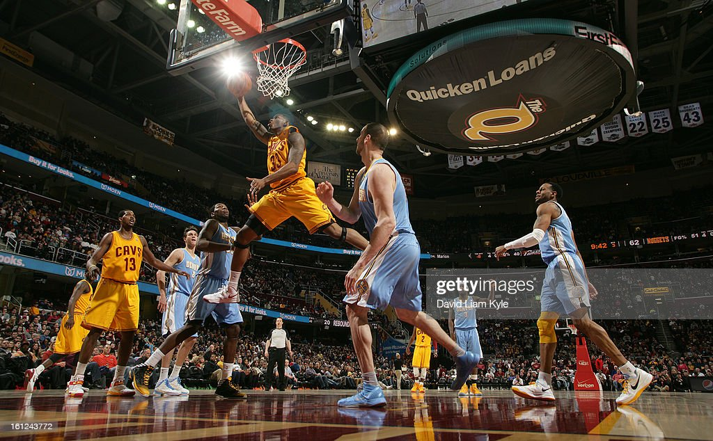Alonzo Gee #33 of the Cleveland Cavaliers goes up for the shot against Kenneth Faried #35 and Kosta Koufos #41 of the Denver Nuggets at The Quicken Loans Arena on February 9, 2013 in Cleveland, Ohio.