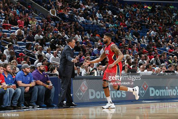 Alonzo Gee of the New Orleans Pelicans shakes hands with head coach Alvin Gentry of the New Orleans Pelicans during the game against the Toronto...