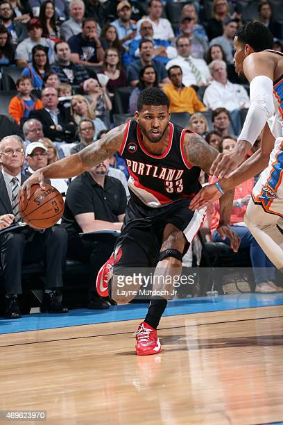 Alonzo Gee of the Portland Trail Blazers drives against the Oklahoma City Thunder on April 13 2015 at Chesapeake Energy Arena in Oklahoma City...