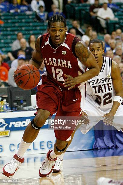 Alonzo Gee of the University of Alabama Crimson Tide drives the ball around Barry Stewart of the Mississippi State University Bulldogs during the SEC...