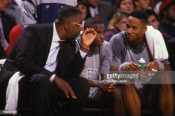 Alonzo Mourning and John Thompson, head of the Georgetown Hoyas, talk during a basketball game against the Providence Frairs at Capital Centre on...