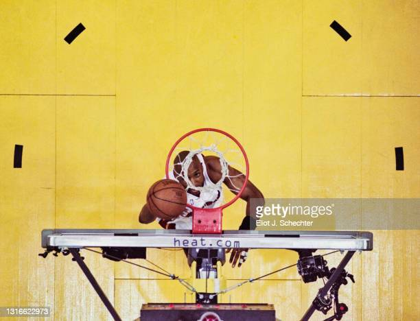 Alonzo Mourning, Center and Power Forward for the Miami Heat looks up through the basketball hoop after making a lay up shot during Game 1 of the NBA...