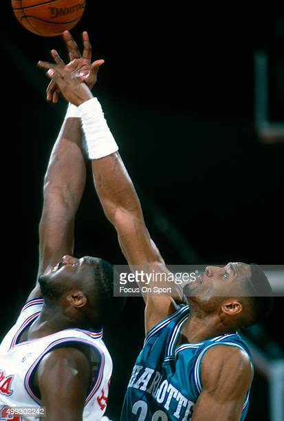 Alonzo Mourning of the Charlotte Hornets battles for a rebound against the Los Angeles Clippers during an NBA basketball game circa 1992 at Los...