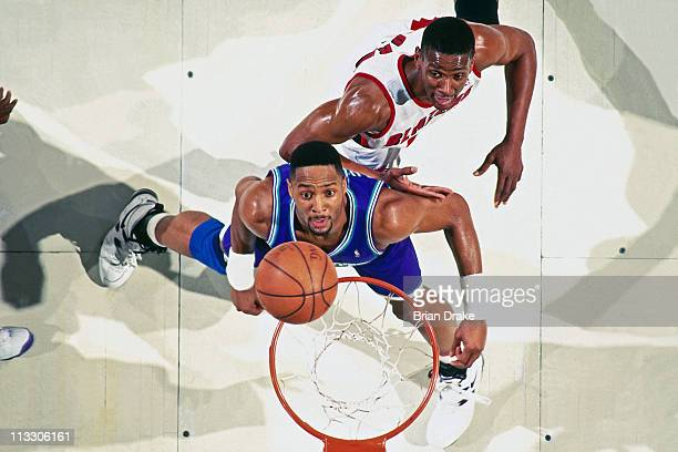 Alonzo Mourning of the Charlotte Hornets boxes out against Otis Thorpe of the Portland Trailblazers at the Veterans Memorial Coliseum circa 1995 in...
