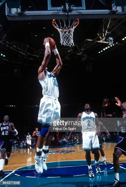 Alonzo Mourning of the Charlotte Hornets goes up for a slam dunk against the Sacramento Kings during an NBA basketball game circa 1993 at the...