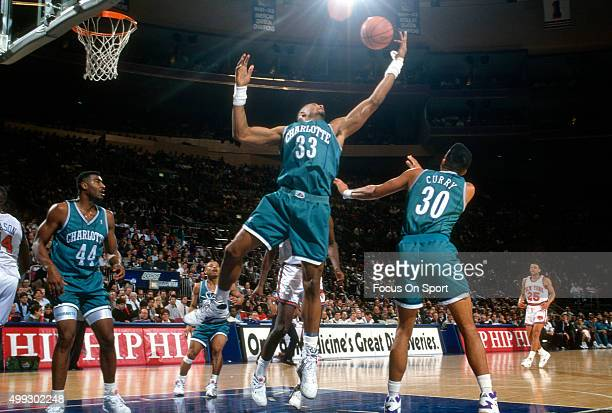 Alonzo Mourning of the Charlotte Hornets grabs a rebound against the New York Knicks during an NBA basketball game circa 1992 at Madison Square...
