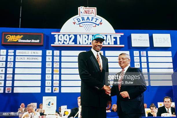 Alonzo Mourning of the Charlotte Hornets shakes hands with Commisoner David Stern after being selected second at the 1992 NBA Draft on June 24 1992...