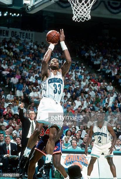 Alonzo Mourning of the Charlotte Hornets shoots against the New York Knicks during an NBA basketball game circa 1992 at the Charlotte Coliseum in...