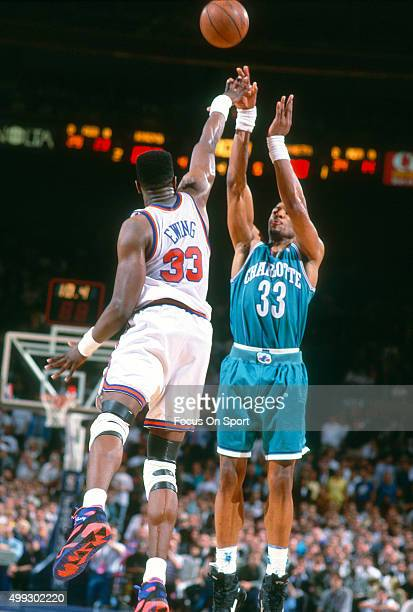 Alonzo Mourning of the Charlotte Hornets shoots over Patrick Ewing of the New York Knicks during an NBA basketball game circa 1992 at Madison Square...