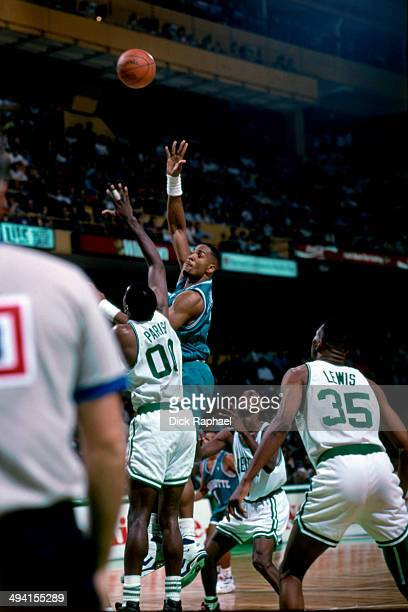 Alonzo Mourning of the Charlotte Hornets takes a shot against Robert Parish of the Boston Celtics during a game played at the Boston Garden in Boston...