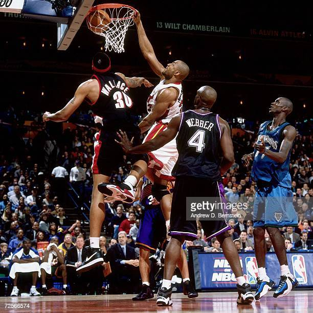 Alonzo Mourning of the Eastern Conference AllStars dunks over Rasheed Wallace of the Western Conference AllStars during the 2000 NBA AllStar Game...
