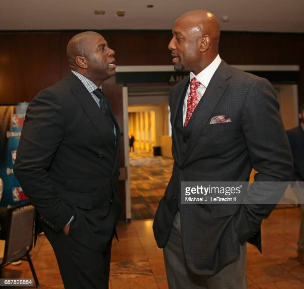 Alonzo Mourning of the Miami Heat and Magic Johnson of the Los Angeles Lakers talk during the 2017 NBA Draft Lottery at the New York Hilton in New...