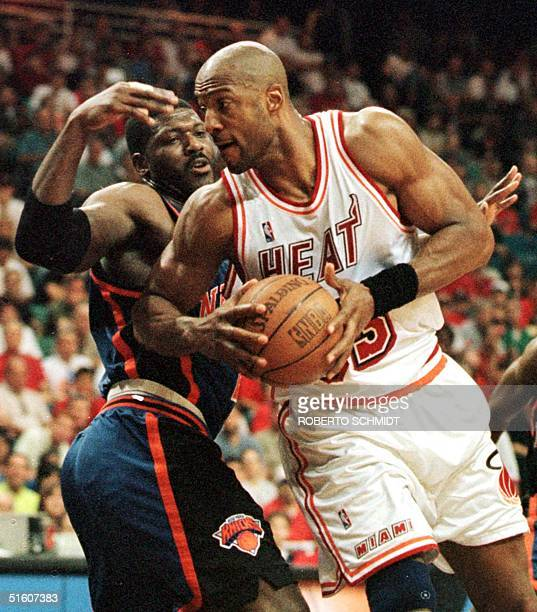 Alonzo Mourning of the Miami Heat drives past Larry Johnson of the New York Knicks to score in first half action 16 May 1999 during game five of...