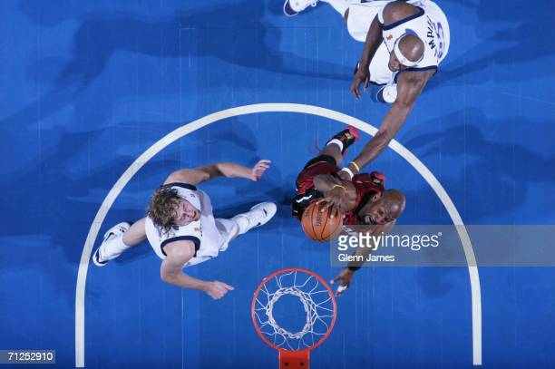 Alonzo Mourning of the Miami Heat dunks against Dirk Nowitzki of the Dallas Mavericks in Game Six of the 2006 NBA Finals on June 20 2006 at the...