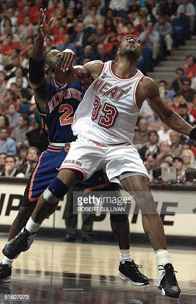 Alonzo Mourning of the Miami Heat fights for position with Larry Johnson of the New York Knicks in first quarter action 10 May 1999 during game two...