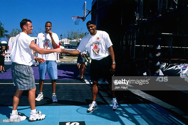 Alonzo Mourning of the Miami Heat participates in the Heat Family Festival event circa 1998 in Miami Florida NOTE TO USER User expressly acknowledges...