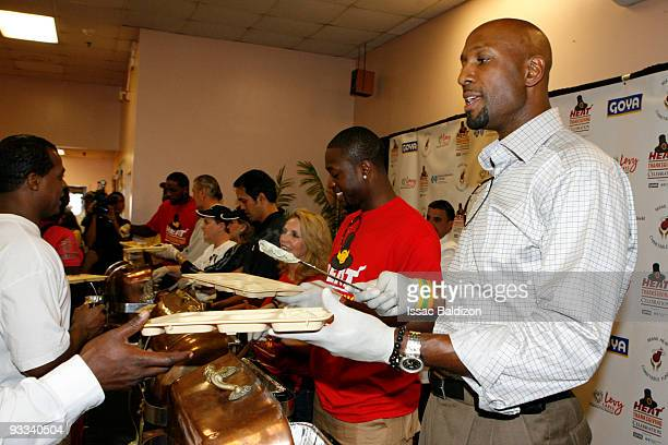 Alonzo Mourning of the Miami Heat participates in the Miami Heat's Annual Thanksgiving in Overtown Ceremony on November 23 2009 at the Miami Rescue...