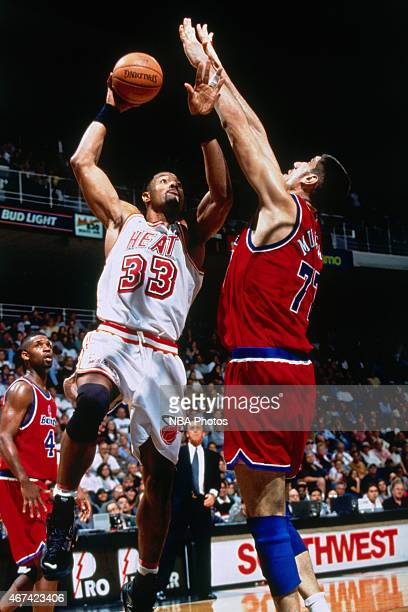 Alonzo Mourning of the Miami Heat shoots against Gheorge Muresan of the Washington Bullets on March 29 1996 at Miami Arena in Miami Florida NOTE TO...